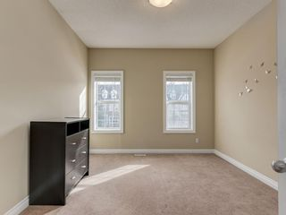 Photo 22: 81 Somme Boulevard SW in Calgary: Garrison Woods Residential for sale : MLS®# A1072185