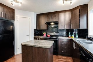 Photo 7: 107 2445 Kingsland Road SE: Airdrie Row/Townhouse for sale : MLS®# A1151788