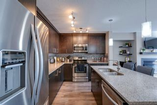 Photo 1: 203 Evanston Manor NW in Calgary: Evanston Row/Townhouse for sale : MLS®# A1149522