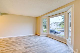 Photo 10: 215 Strathearn Crescent SW in Calgary: Strathcona Park Detached for sale : MLS®# A1146284