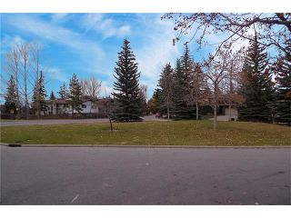 Photo 2: 128 PUMP HILL Green SW in Calgary: Pump Hill House for sale : MLS®# C4037555