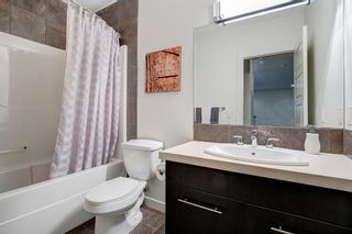 Photo 33: 127 Springbluff Boulevard SW in Calgary: Springbank Hill Detached for sale : MLS®# A1140601