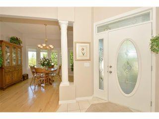 Photo 3: 134 GLENEAGLES View: Cochrane House for sale : MLS®# C4018773