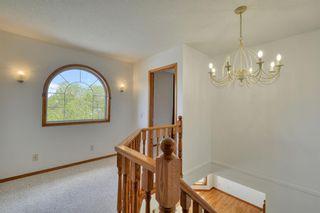 Photo 37: 12 West Hall Place: Cochrane Detached for sale : MLS®# A1119224