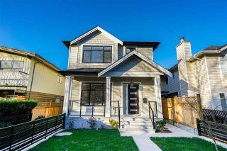 Photo 1: 8377 LAUREL Street in Vancouver: Marpole 1/2 Duplex for sale (Vancouver West)  : MLS®# R2422490