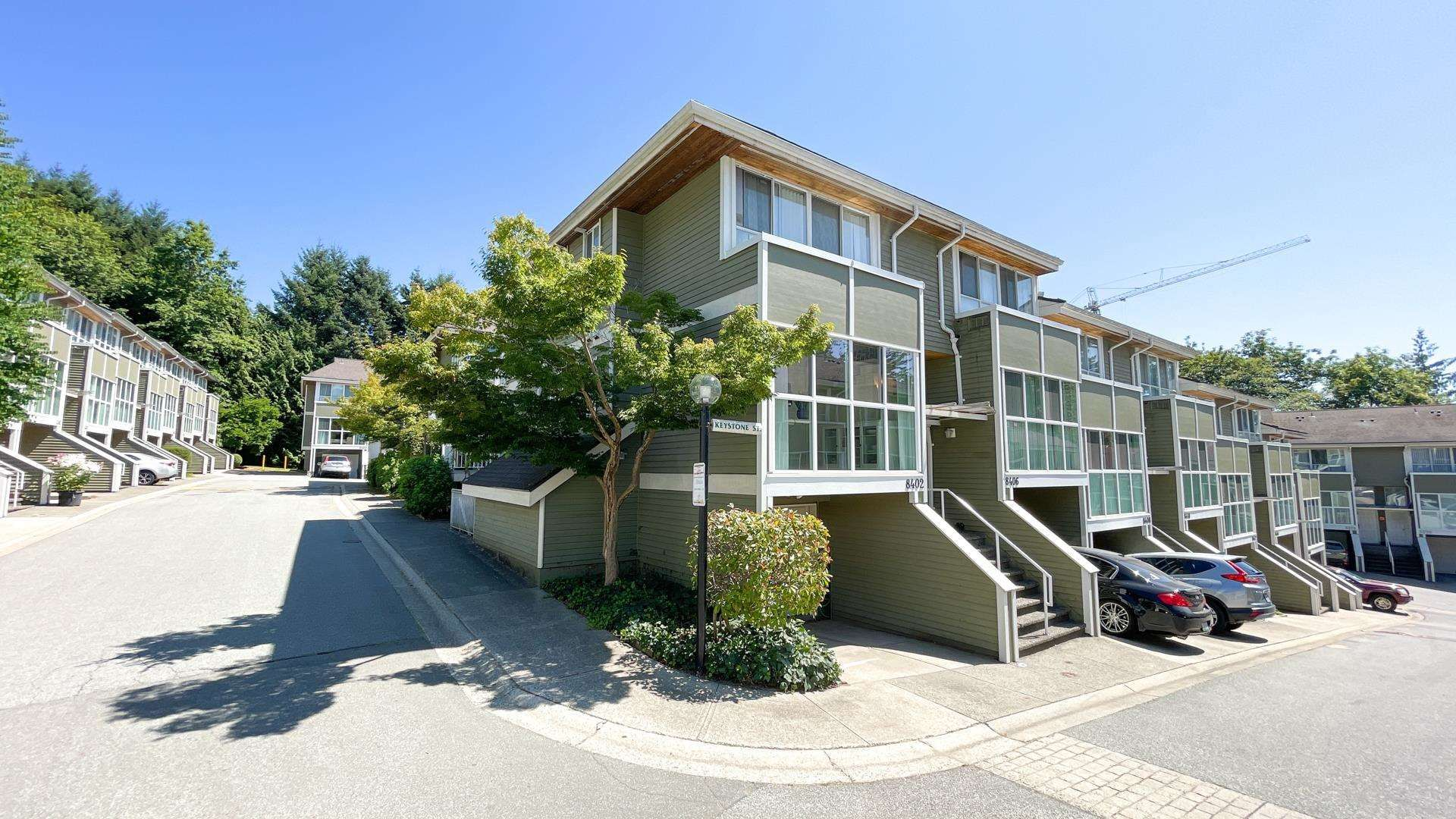 """Main Photo: 8402 KEYSTONE Street in Vancouver: Champlain Heights Townhouse for sale in """"Marine Woods"""" (Vancouver East)  : MLS®# R2606648"""