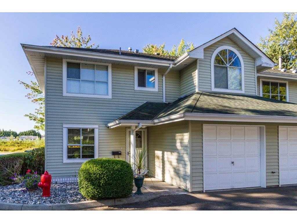 """Main Photo: 101 15439 100 Avenue in Surrey: Guildford Townhouse for sale in """"PLUM TREE LANE"""" (North Surrey)  : MLS®# R2095755"""