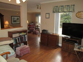 """Photo 5: 210 2451 GLADWIN Road in Abbotsford: Abbotsford West Condo for sale in """"Centennial Court"""" : MLS®# R2145469"""