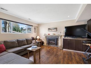 Photo 18: 13311 SUTTON Place in Surrey: Queen Mary Park Surrey House for sale : MLS®# R2561356