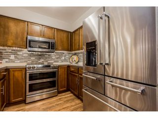 """Photo 11: 204 32098 GEORGE FERGUSON Way in Abbotsford: Abbotsford West Condo for sale in """"Heather Court"""" : MLS®# R2399610"""