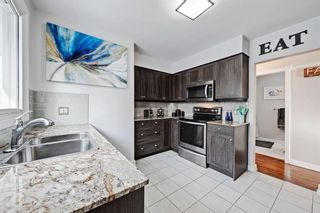 Photo 10: 710 53 Avenue SW in Calgary: Windsor Park Semi Detached for sale : MLS®# A1067398