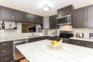 Photo 4: 1317 3240 66 Avenue SW in Calgary: Lakeview Row/Townhouse for sale : MLS®# C4214775