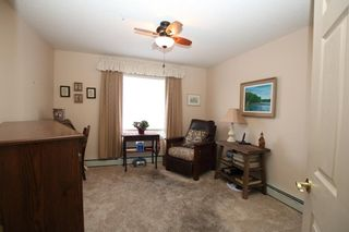 Photo 7: 205 305 1 Avenue NW: Airdrie Apartment for sale : MLS®# A1083807