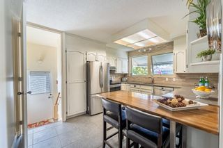 Photo 5: 6128 Longmoor Way SW in Calgary: Lakeview Detached for sale : MLS®# A1150514