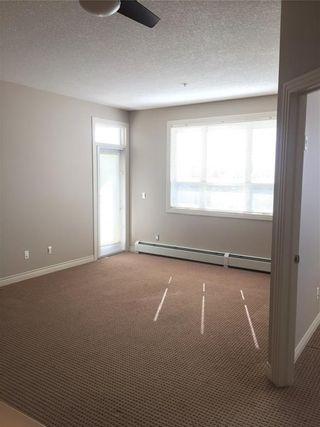 Photo 2:  in Calgary: Springbank Hill Condo for sale : MLS®# C4136490