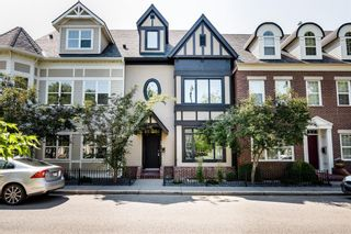 Photo 1: 29 Somme Boulevard SW in Calgary: Garrison Woods Row/Townhouse for sale : MLS®# A1129180