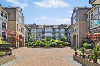 """Photo 1: 124 20200 56 Avenue in Langley: Langley City Condo for sale in """"THE BENTLEY"""" : MLS®# R2585180"""