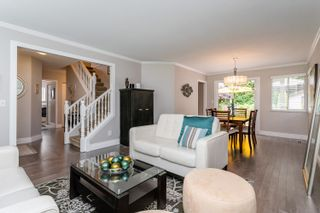 Photo 2: 23 FLAVELLE Drive in Port Moody: Barber Street House for sale : MLS®# R2599334