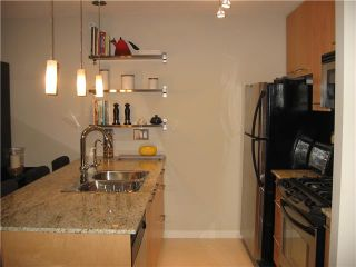 Photo 2: 703 2979 GLEN Drive in Coquitlam: North Coquitlam Condo for sale : MLS®# V840551