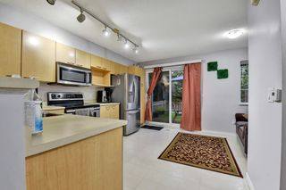 Photo 3: 33 12778 66 Avenue in Surrey: West Newton Townhouse for sale : MLS®# R2625806