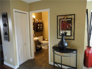 Photo 9: 266 BRIDLEWOOD Circle SW in Calgary: Bridlewood House for sale : MLS®# C4031965