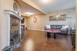 Photo 4: 56 Abberfield Court NE in Calgary: Abbeydale Row/Townhouse for sale : MLS®# A1115088
