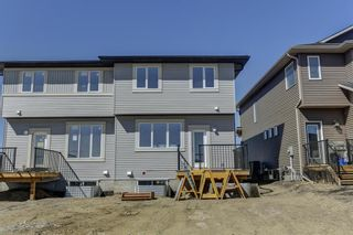Photo 30: 132 Creekside Drive SW in Calgary: C-168 Semi Detached for sale : MLS®# A1098272