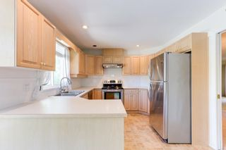 """Photo 7: 129 13888 70TH Avenue in Surrey: East Newton Townhouse for sale in """"Chelsea Gardens"""" : MLS®# R2594472"""
