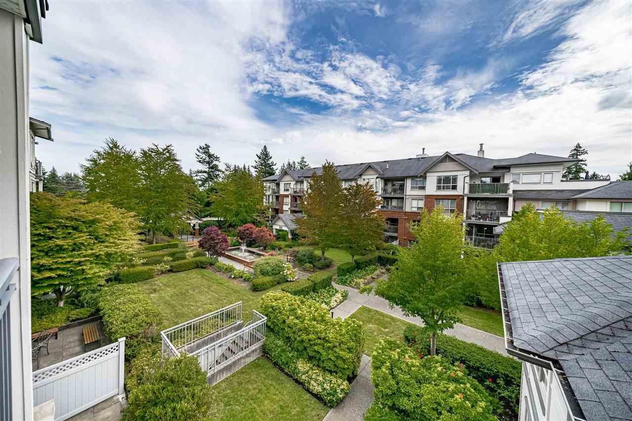 "Photo 1: Photos: 306 15188 22 Avenue in Surrey: Sunnyside Park Surrey Condo for sale in ""Muirfield Gardens"" (South Surrey White Rock)  : MLS®# R2523832"