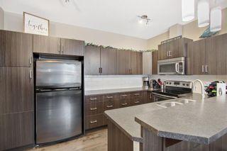 Photo 4: 1204 10 AUBURN BAY Avenue SE in Calgary: Auburn Bay Row/Townhouse for sale : MLS®# A1065411