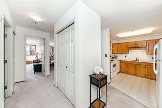 """Photo 2: 312 5710 201 Street in Langley: Langley City Condo for sale in """"WHITE OAKS"""" : MLS®# R2387162"""