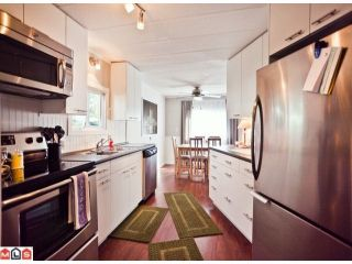 """Photo 1: 238 1840 160TH Street in Surrey: King George Corridor Manufactured Home for sale in """"BREAKAWAY BAYS"""" (South Surrey White Rock)  : MLS®# F1223433"""
