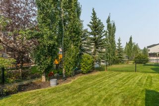Photo 30: 175 Cougarstone Court SW in Calgary: Cougar Ridge Detached for sale : MLS®# A1130400