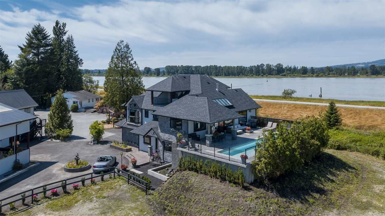 Main Photo: 18681 MCQUARRIE Road in Pitt Meadows: North Meadows PI House for sale : MLS®# R2605629