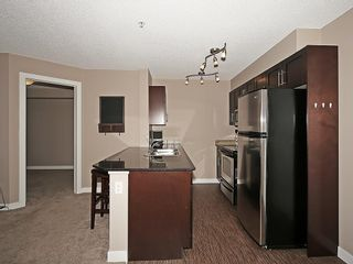 Photo 4: 2211 403 MACKENZIE Way SW: Airdrie Condo for sale : MLS®# C4115283