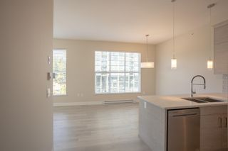 """Photo 14: 406 2120 GLADWIN Road in Abbotsford: Central Abbotsford Condo for sale in """"THE ONYX AT MAHOGANY"""" : MLS®# R2614339"""