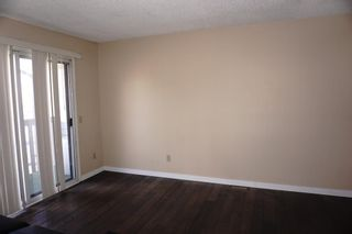 Photo 5: A 1215 44 Street SE in Calgary: Forest Lawn Row/Townhouse for sale : MLS®# A1116563