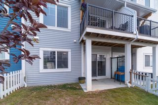 Photo 38: 907 Jumping Pound Common: Cochrane Row/Townhouse for sale : MLS®# A1132952