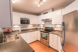 """Photo 13: 433 2980 PRINCESS Crescent in Coquitlam: Canyon Springs Condo for sale in """"Montclaire"""" : MLS®# R2101086"""