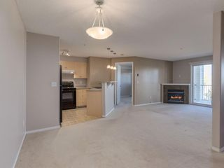 Photo 2: 1312 4975 130 Avenue SE in Calgary: McKenzie Towne Apartment for sale : MLS®# A1046077