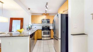 """Photo 2: 313 7418 BYRNEPARK Walk in Burnaby: South Slope Condo for sale in """"GREEN"""" (Burnaby South)  : MLS®# R2501039"""