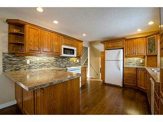 Photo 4: 1708 107 Avenue SW in Calgary: Braeside_Braesde Est Residential Detached Single Family for sale : MLS®# C3651455