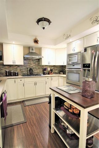 Photo 7: 14 448 Strathcona Drive SW in Calgary: Strathcona Park Row/Townhouse for sale : MLS®# A1062533