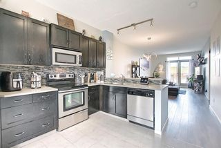 Photo 6: 2304 125 Panatella Way NW in Calgary: Panorama Hills Row/Townhouse for sale : MLS®# A1121817
