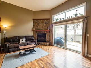 Photo 3: 20 23 Glamis Drive SW in Calgary: Glamorgan Row/Townhouse for sale : MLS®# A1108158