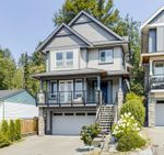 Main Photo: 313 AVALON Drive in Port Moody: North Shore Pt Moody House for sale : MLS®# R2619716