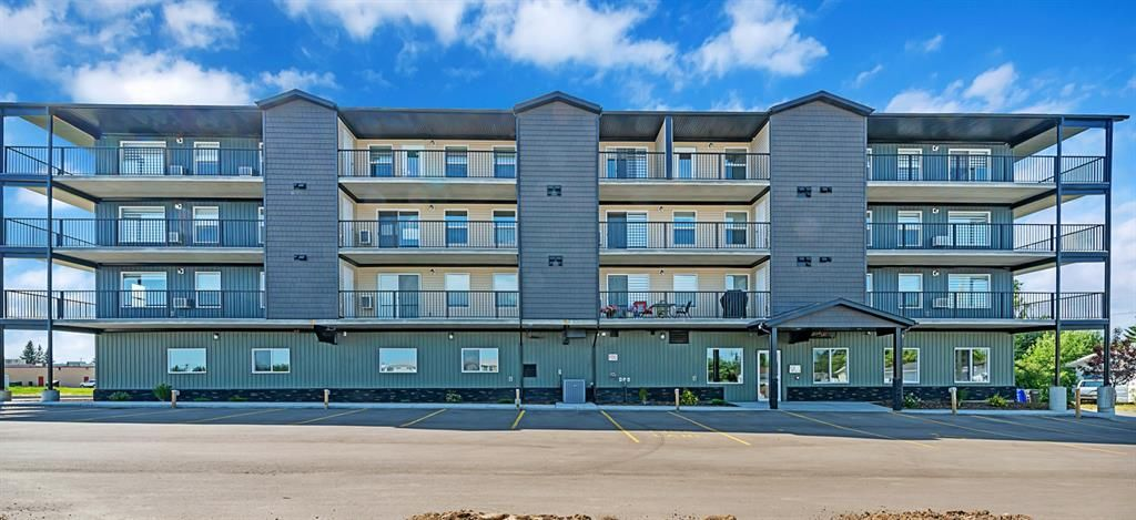 Main Photo: 203 4574 51 Avenue: Olds Apartment for sale : MLS®# A1140330