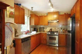 Photo 2: 104 2958 WHISPER WAY in Coquitlam: Westwood Plateau Condo for sale : MLS®# R2099902