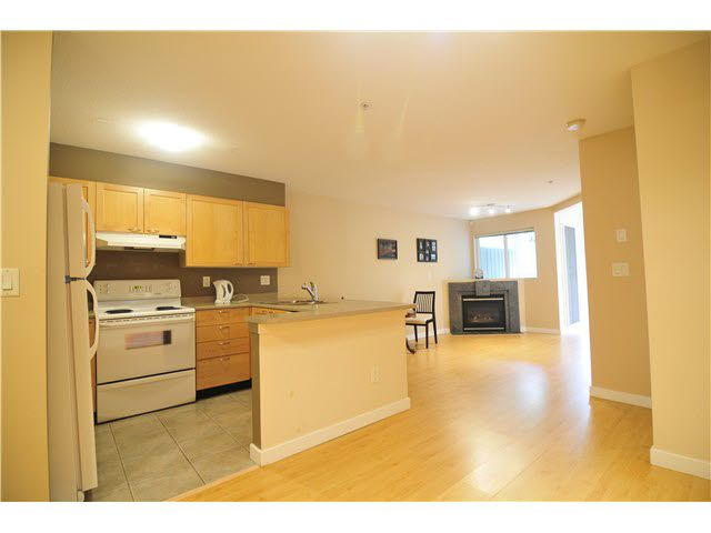 """Main Photo: 201 7383 GRIFFITHS Drive in Burnaby: Highgate Condo for sale in """"EIGHTEEN TREES"""" (Burnaby South)  : MLS®# R2046692"""
