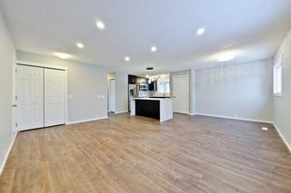 Photo 3: 100 DOVERVIEW Place SE in Calgary: Dover Detached for sale : MLS®# A1024220